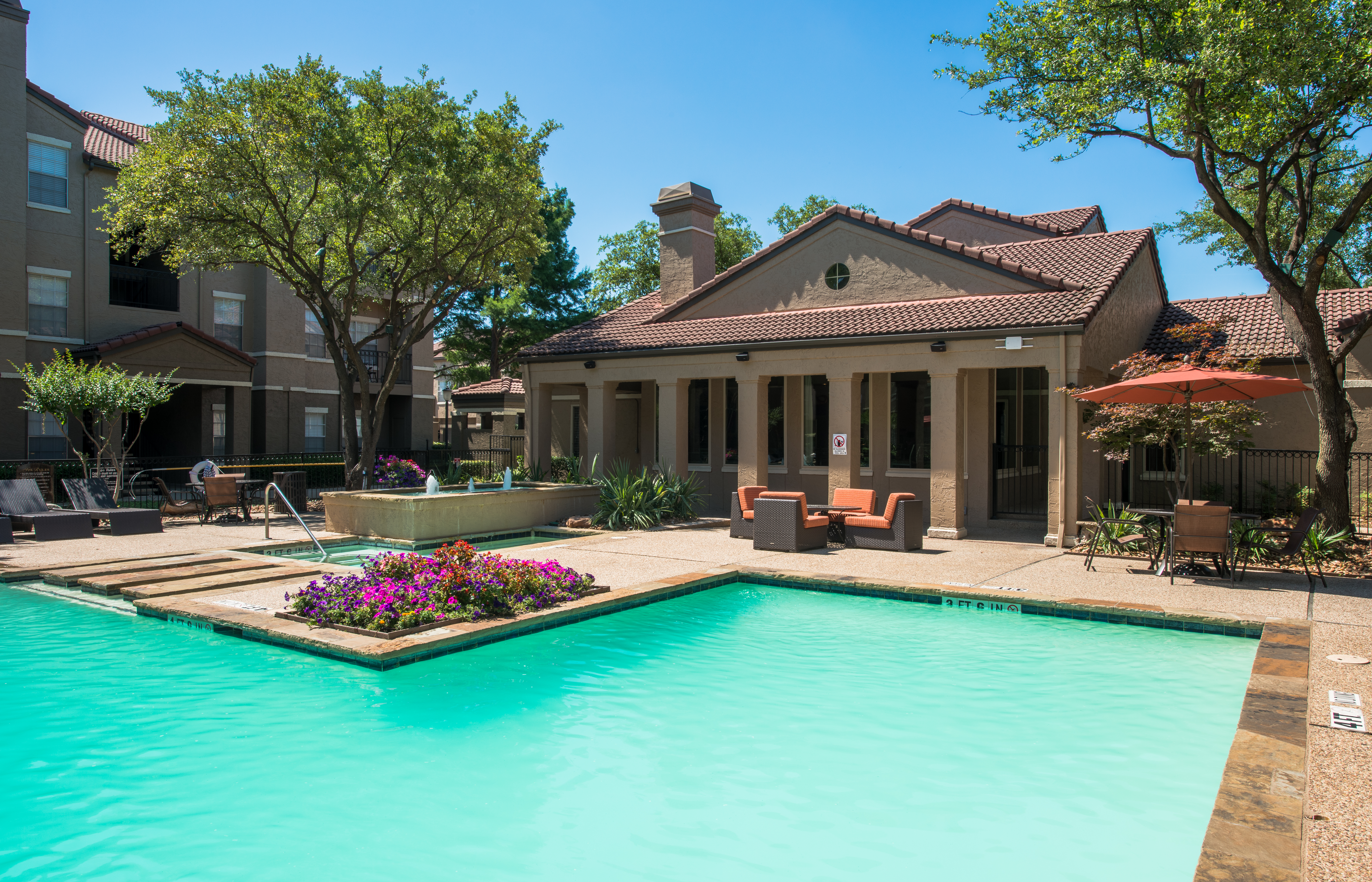Swimming Pool with Lounge Chairs at Camden Cimarron Apartments in Dallas, TX