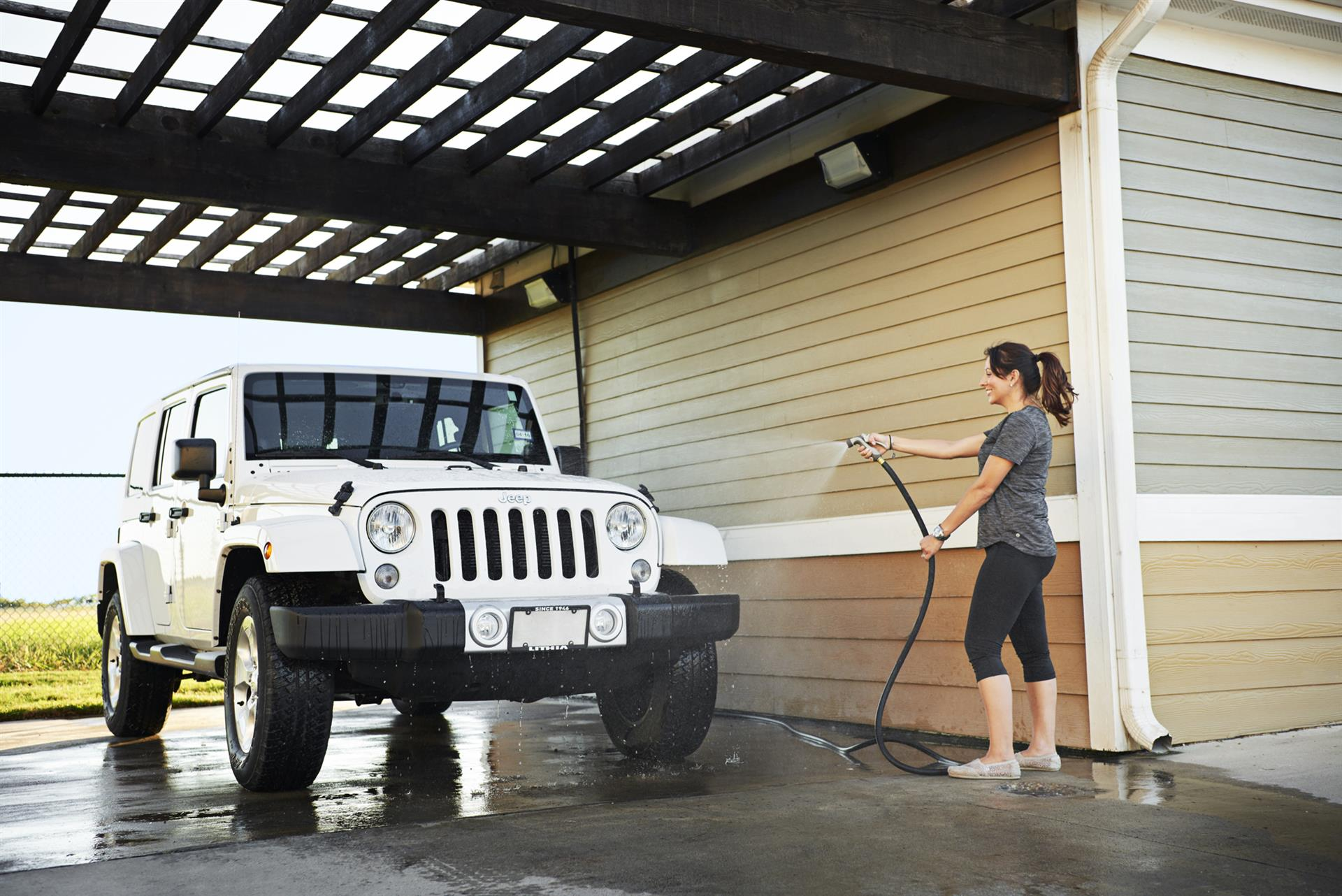 Girl washing jeep at Camden South Bay