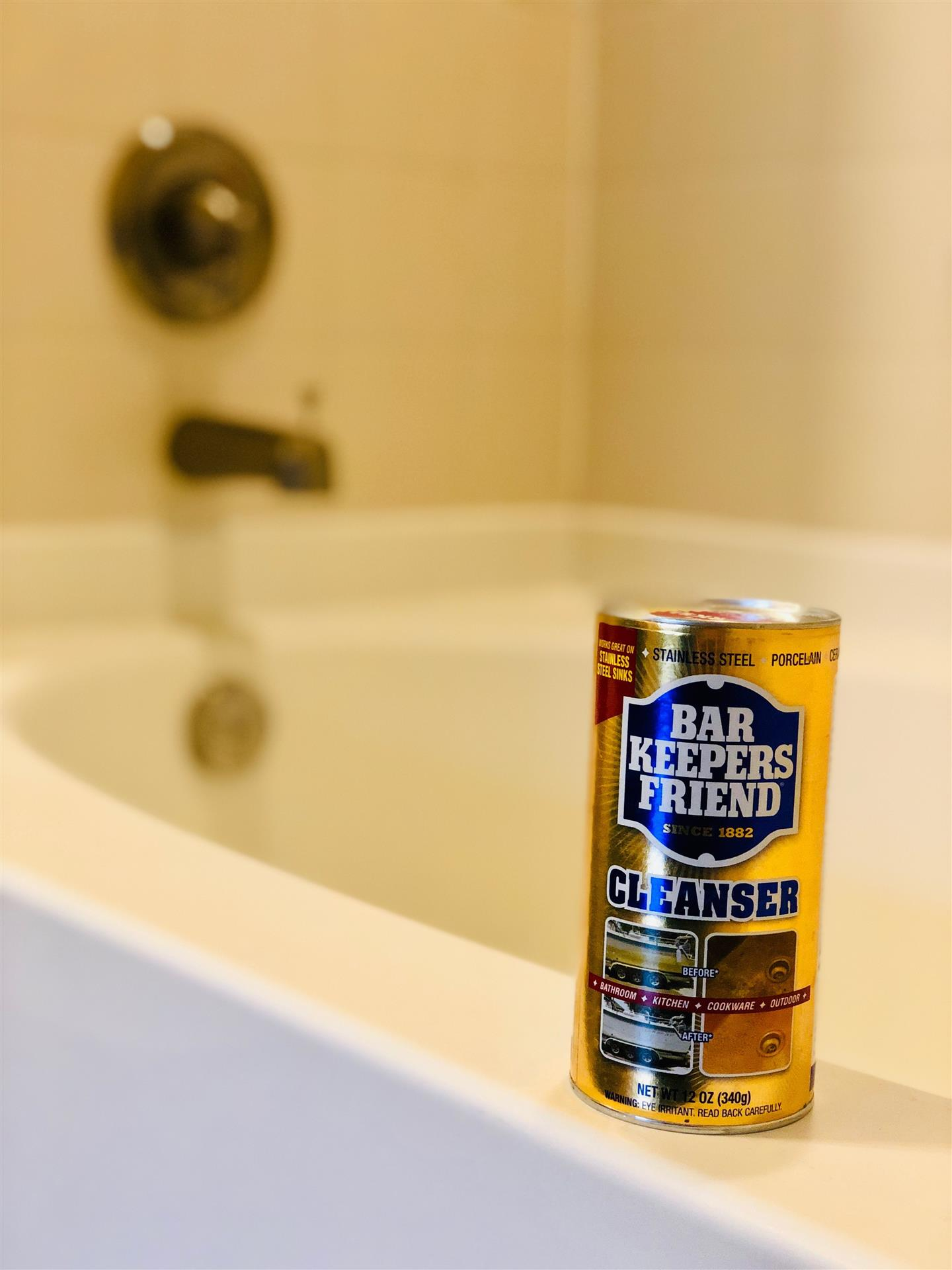 Bar Keepers Friend on side of tub