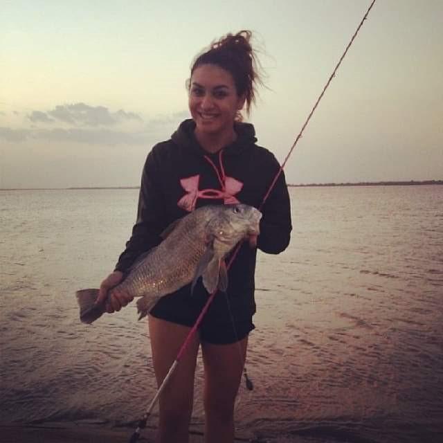 Bella fishing at Red Dot Pier