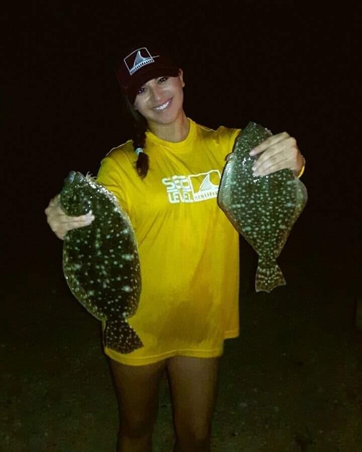 Bella holding flounder at Nueces Bay