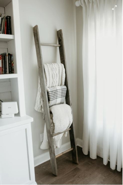 Ladder with blankets hung