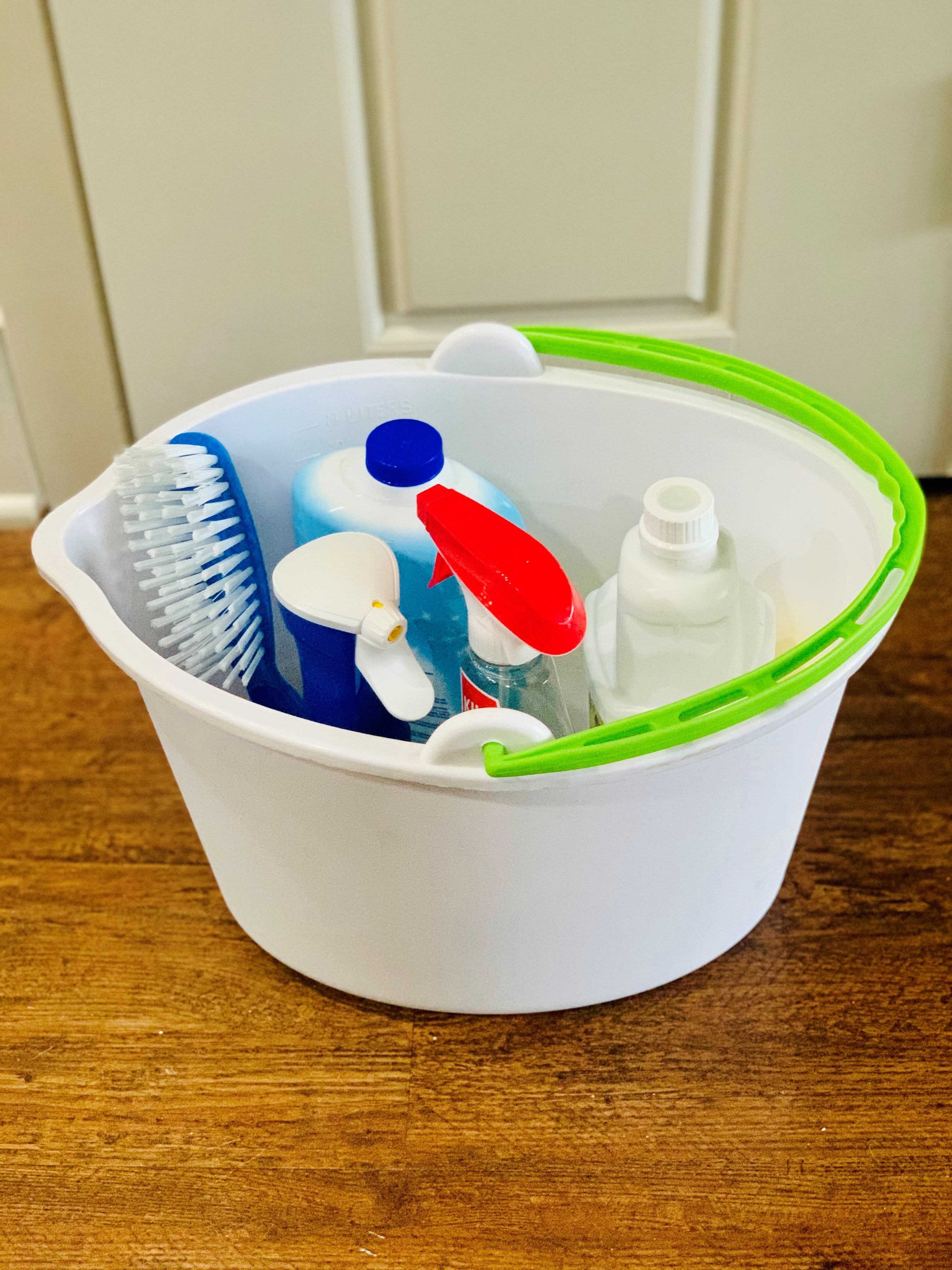Cleaning products stored in a mop bucket