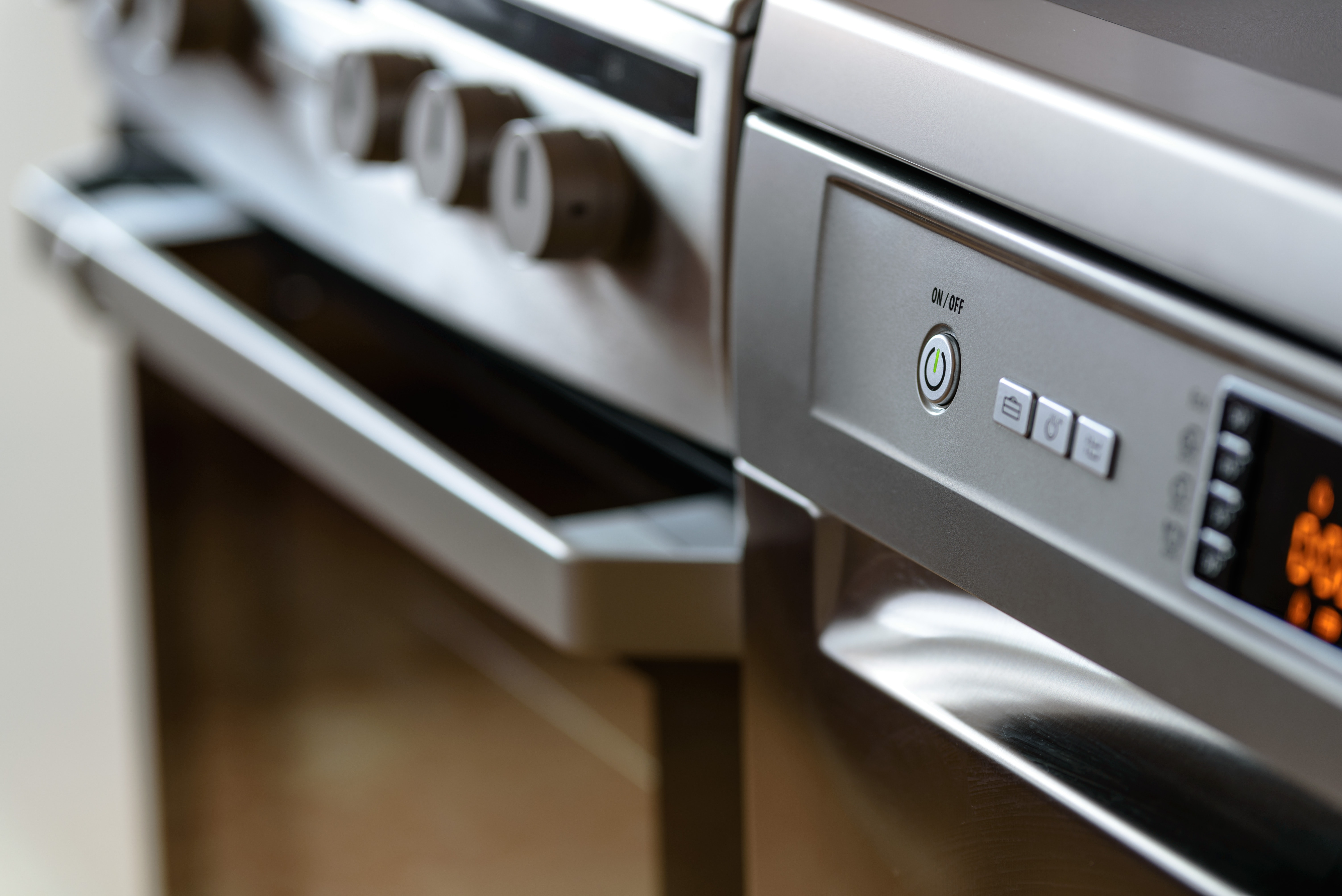 Sleek oven and stove with control knobs
