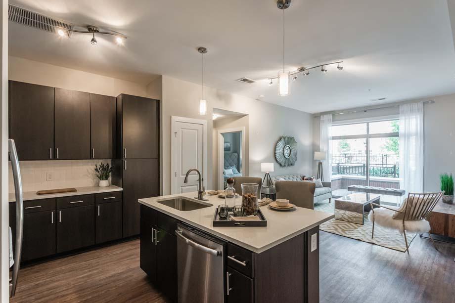 camden-franklin-park-apartments-franklin-tn-brown-interior-kitchen-and-living.jpg