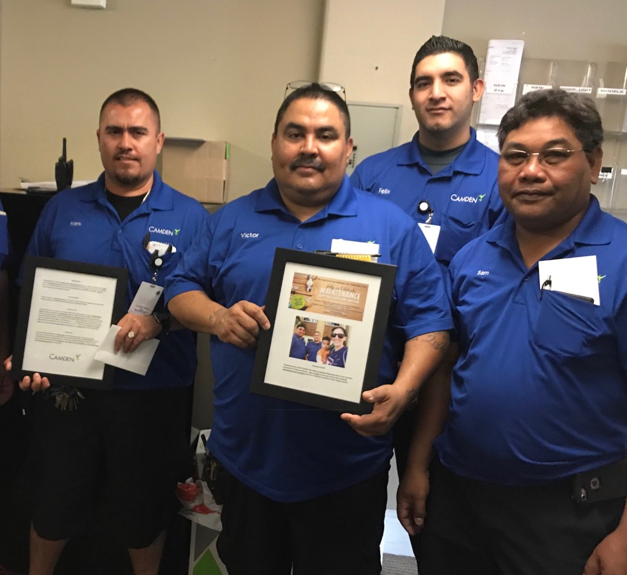 Frank Arciga and the Camden Harbor View Maintenance team with their resident testimonial plaques