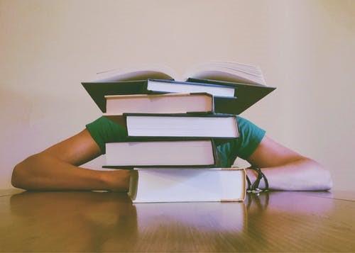 person_behind_books.jpg