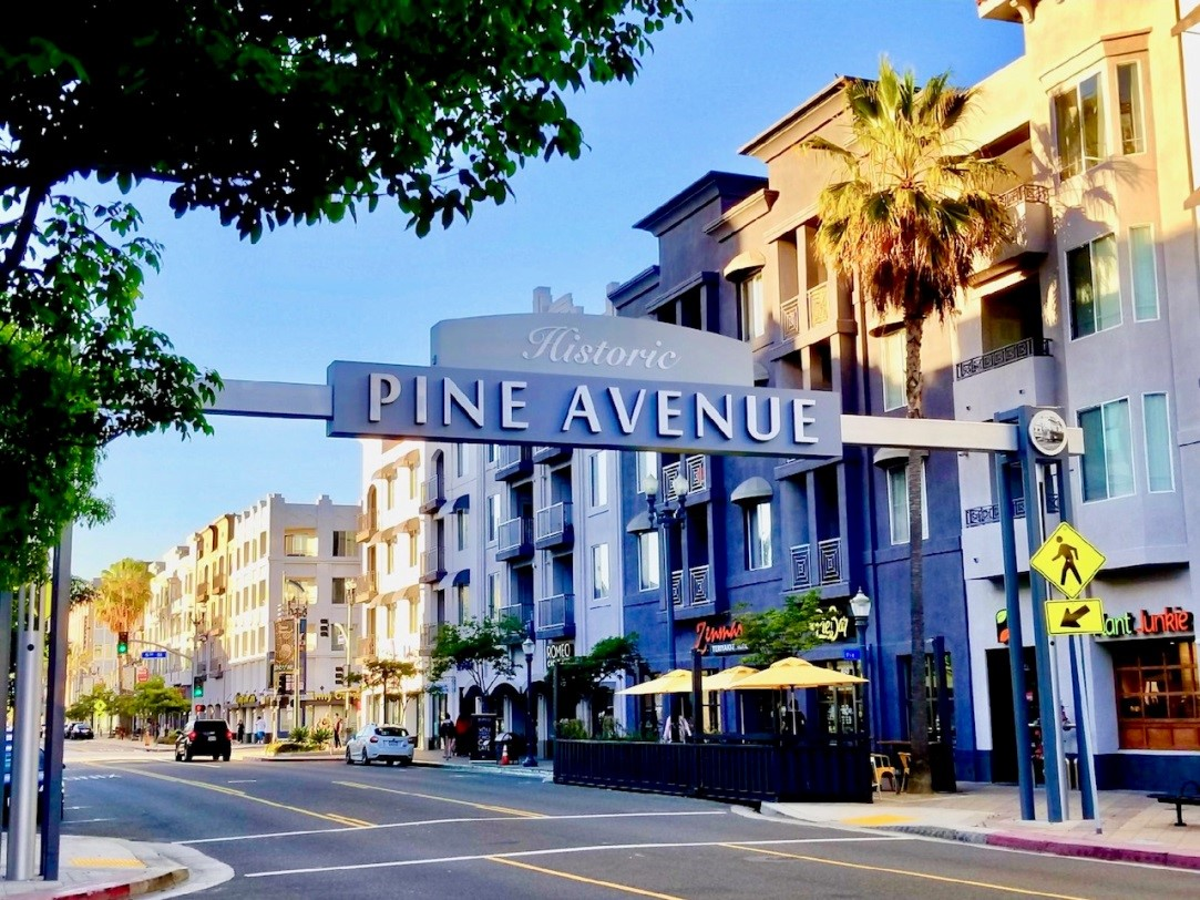The Pine Ave. sign that stretches across Pine Ave. between 4th and 5th streets.