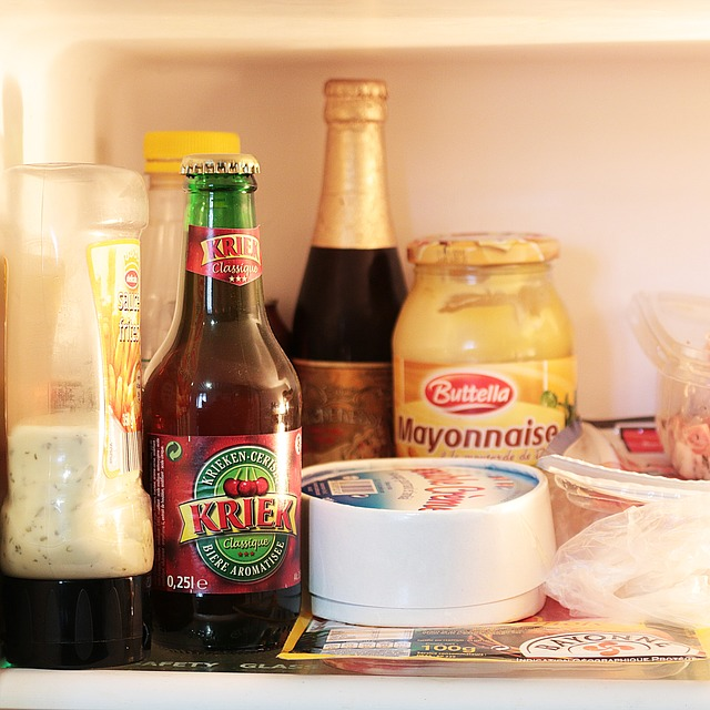 Cluttered fridge shelf.