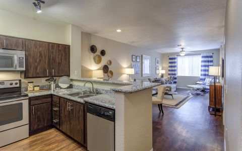 Apartment Kitchen with Granite Countertops at Camden Crown Valley in Mission Viejo, California