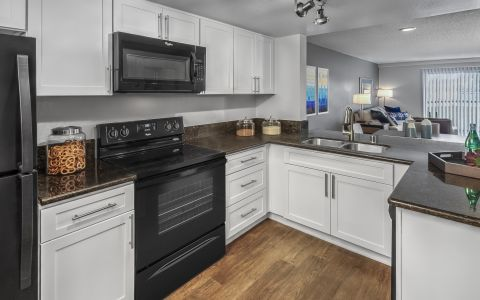 Kitchen with granite countertops at Camden Sea Palms Apartments in Costa Mesa, California