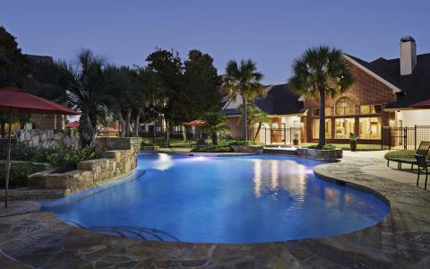 Swimming Pool at Night at Camden Sugar Grove Apartments in Stafford, Texas