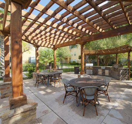 Outdoor Grills and Dining Areas at Camden Breakers Apartments in Corpus Christi, TX