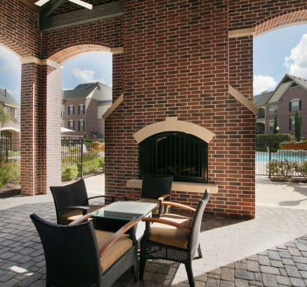 Outdoor Fireplace at Camden Cypress Creek Apartments in Houston, TX