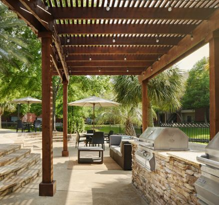 Outdoor Grills and Dining Areas at Camden Holly Springs Apartments in Houston, TX