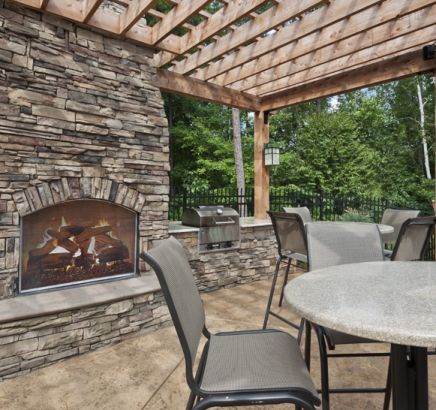 Outdoor fireplace at Camden Overlook Apartments in Raleigh, NC