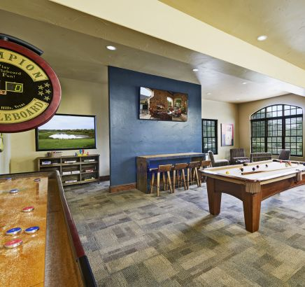 Gaming Lounge with Shuffle Board at Camden Riverwalk Apartments in Grapevine, TX.