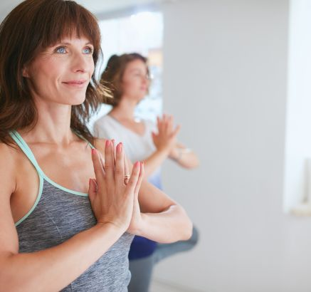 Yoga and fitness classes at Camden Royal Oaks Apartments in Houston, TX
