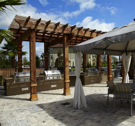 Pool Cabanas Grills at Camden Town Square Apartments in Kissimmee, FL
