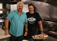 """•Chef George Patti and Guy Fieri on set for Diners, Drive-ins and Dives (Season 24, Episode 8: """"Hot Meat and Cool Veg"""" aired April 22, 2016) pictured with Housemade Pork Rinds and Chimichurri Aioli; photo courtesy of M.E.A.T. Eatery And Taproom"""