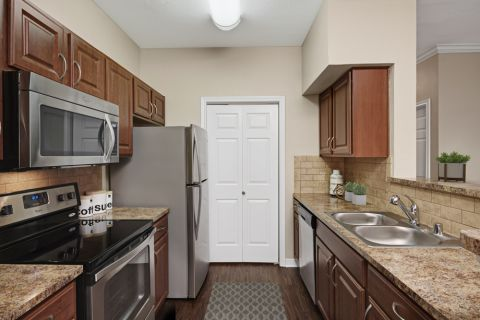 Kitchen with Stainless Steel Appliances at Camden Addison Apartments in Addison, TX