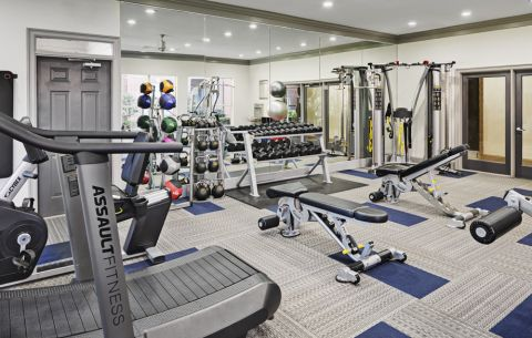 Fitness Center with cardio at Camden Addison Apartments in Addison, TX