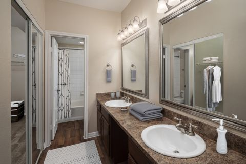 Bathroom with double sinks at Camden Addison Apartments in Addison, TX