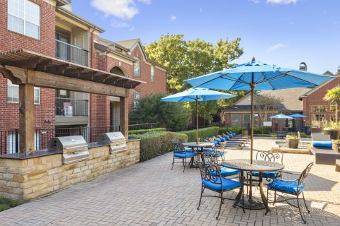 Grills and Outdoor Seating at Camden Addison Apartments in Addison, TX