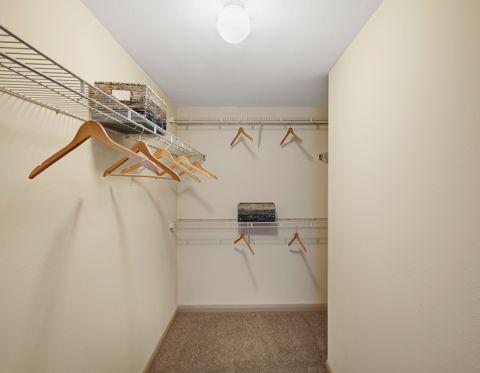 Walk in closet at Camden Amber Oaks Apartments in Austin, TX