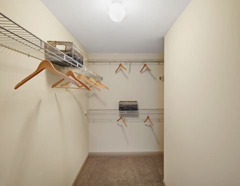Walk in closet at Camden Amber Oaks Apartments in Austin, TX