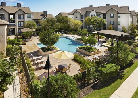 Resort-style pool at Camden Amber Oaks Apartments in Austin, TX