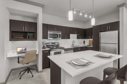 Open concept living with work and study space at Camden Asbury Village Apartments in Raleigh, NC