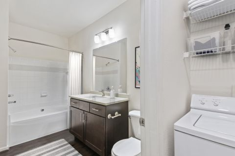 Bathroom and laundry room at Camden Ashburn Farm Apartments in Ashburn, VA