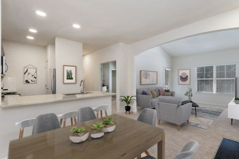 Dining and living room at Camden Ashburn Farm Apartments in Ashburn, VA