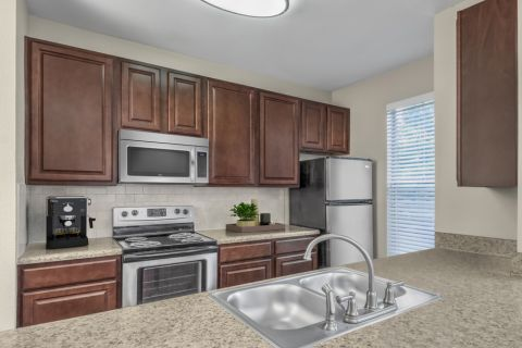 Kitchen with stainless steel appliances at Camden Ballantyne Apartments in Charlotte, NC