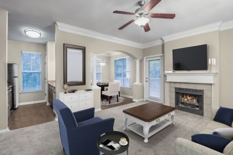 Living Room, Dining Room, and Kitchen at Camden Ballantyne Apartments in Charlotte, NC