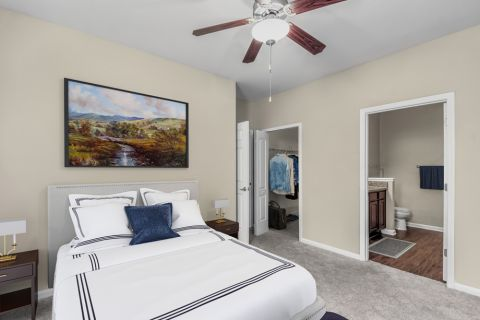 Bedroom with walk-in closet at Camden Ballantyne Apartments in Charlotte, NC