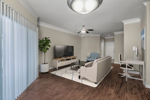 Living room with home office at Camden Ballantyne Apartments in Charlotte, NC