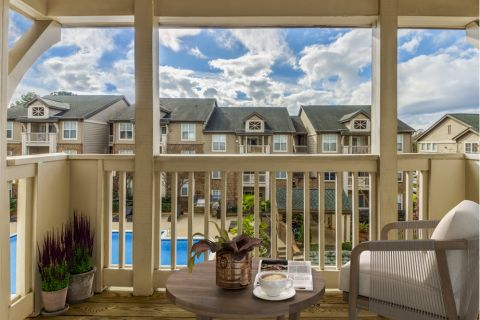 Balcony overlooking pool at Camden Ballantyne Apartments in Charlotte, NC
