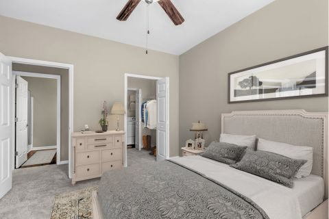 Bedroom with Washer and Dryer at Camden Ballantyne Apartments in Charlotte, NC