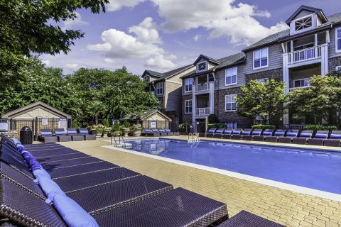 Lounge Chairs at the Swimming Pool at Camden Ballantyne Apartments in Charlotte, NC