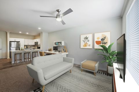 Living Room with home office space and modern finishes at Camden Belleview Station Apartments in Denver, CO