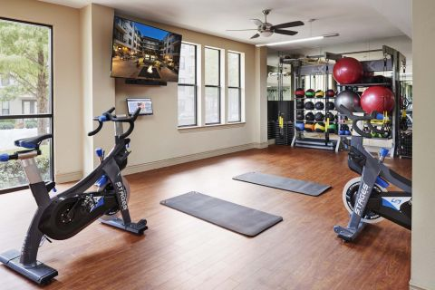 Fitness Center with Spin Bikes at Camden Belmont Apartments in Dallas, TX