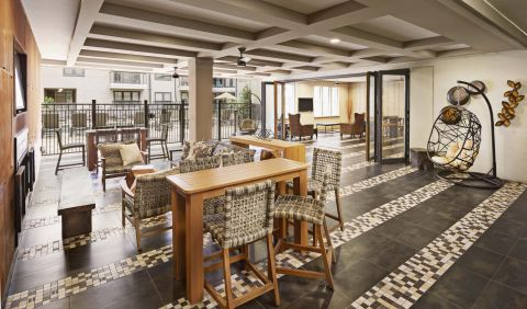 Indoor Outdoor Resident Lounge at Camden Belmont Apartments in Dallas, TX