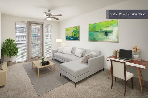 Living room with home office space at Camden Belmont Apartments in Dallas, TX