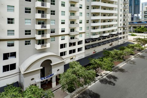 Exterior with new black awnings at Camden Brickell Apartments in Miami, FL