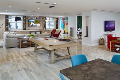 Resident Clubroom with Billiards Table at Camden Brickell Apartments in Miami, FL