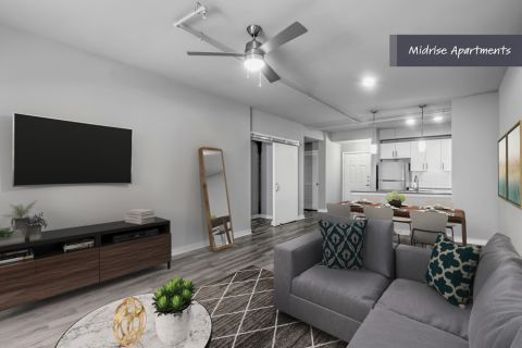 Midrise Apartments Living Room at Camden Brookwood Apartments in Atlanta GA