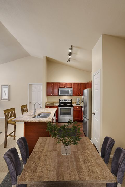 Top Floor Dining Room and Kitchen at Camden Brushy Creek Apartments in Cedar Park, TX