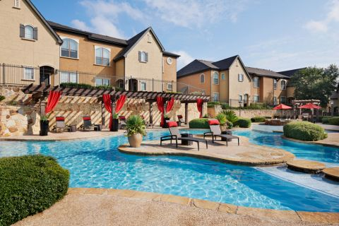 Pool with sundeck and cabanas at Camden Brushy Creek Apartments in Cedar Park, TX